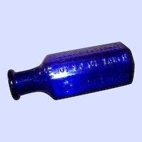 A Collectible Blue Glass Coffin Poison Bottle RICO Not To Be Taken