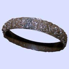 A Delicate Brown Deeply Molded Vintage Bangle Bracelet Mixed Flower Pattern