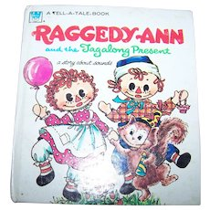 2 Hard Cover  Books Raggedy Ann and the Tagalong Present & Raggedy Andy's Treasure Hunt