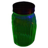 A Green Depression Uranium Glass Hoosier Cabinet Style Shaker