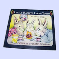 "Soft Cover Booklet Book "" Little Rabbit's Loose Tooth "" by Lucy Bate"