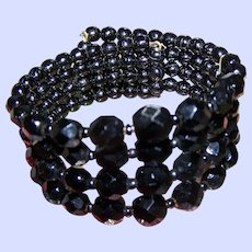 A Lovely Vintage  Four Strand Jet Black Glass Bead Coil  Memory Wrap Mourning  Bracelet