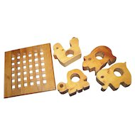 A  Vintage  Wood Hot Plate Stand  Trivet  and Four Charming Carved Figural Animal Napkin Holders