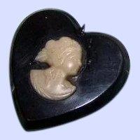 A Small Vintage Black Catalin Heart Plastic Cameo Pendant