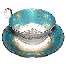 Heavily Decorated Gold Turquoise and White Bone China Tea Cup Saucer Set by Aynsley England