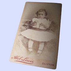 Charming CDV Photograph of a Little Girl with Curly Hair Holding a Necklace