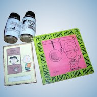 A Lovely Little Collection  of Charlie Brown Collectibles Salt Pepper Shakers Peanuts Cook Books Pkg Book Plates