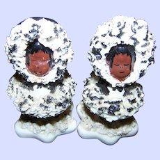 A Charming Set of Vintage Spaghetti Style Eskimo Girl & Boy Salt Pepper Spice Shakers