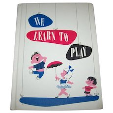 Children's Hard Cover Book We Learn To Play  By Jean Kelleher Porter