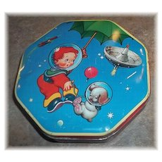 A Decorative Boy In Space Astronaut  with Puppy Wilkin Cremona  Advertising Tin