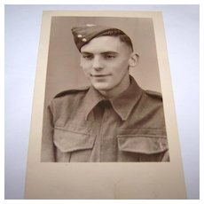 Vintage Sepia Photograph of Soldier in Uniform