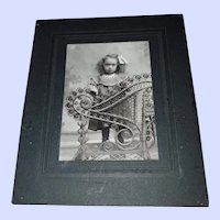 Charming Vintage Photograph of A Little Girl with Wicker Chair
