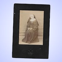 Vintage Cabinet Card Featuring a Nun in Habit with Embossed Fleur De Lis