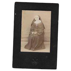 Vintage Cabinet Card Featuring a Nun in Habit with Embossed Fleur De Lis