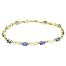 """10K Oval Sapphire* Diamond Accented Infinity Link Bracelet 7"""" Yellow Gold"""