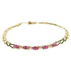 "10K Oval Syn. Ruby Inset Arrow Link Tennis Bracelet 6.75"" Yellow Gold [QRQX]"