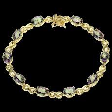 "14K Oval Faceted Mystic Topaz X Link Tennis Bracelet 7.25"" Yellow Gold [CQXS]"
