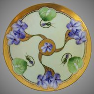 """J.H. Stouffer Company 8 ¼"""" Three Violet Clusters Radiating From Center Cake Plate by Pickard artist Gustav Weissflog """"Gust."""""""