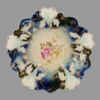 "R.S. Prussia 8 ½"" Iris Mold Cobalt Bowl with Roses"