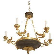 Regency style chandelier with classic brass swans