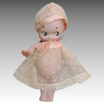 "6"" All bisque perfect Kewpie dressed in net and ribbon dress and hat."