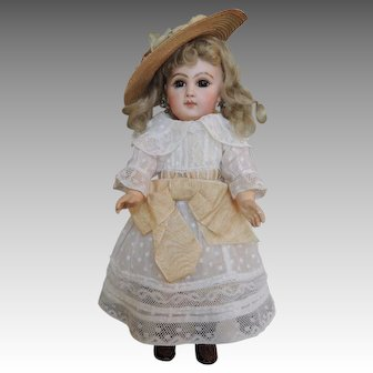 "13"" Stunning E 4 J Jumeau with Dark brown eyes and antique hat"