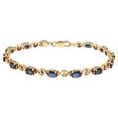 "Oval Sapphire Diamond 14 Karat Yellow Gold ""XO"" Tennis Bracelet"