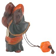 Japanese Antique Polychromed Wooden Netsuke of a Chôkarô 'sennin carrying a gourd with a Faceted Coral ojime