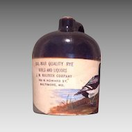 American painted glazed pottery whiskey jug c.1910