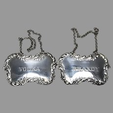 20th C. Pair of American sterling bottle Labels