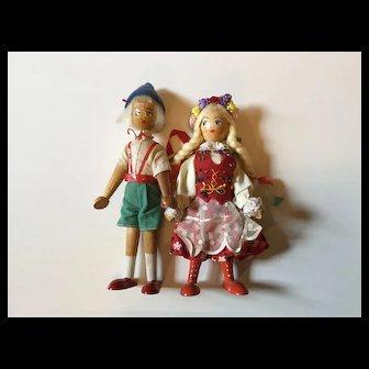 Pair of Mid Century Regionally Dressed Wooden Dolls