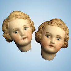 Pr. Of Bisque Molded Hair Doll Heads