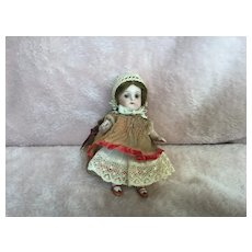 """4"""" German #257 All Bisque Glass Eyed Doll"""