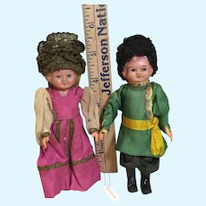 Pair of Celluloid Russian Dolls in Regional Costumes