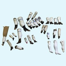 Large Assortment of both Antique and Vintage China Head Doll Legs