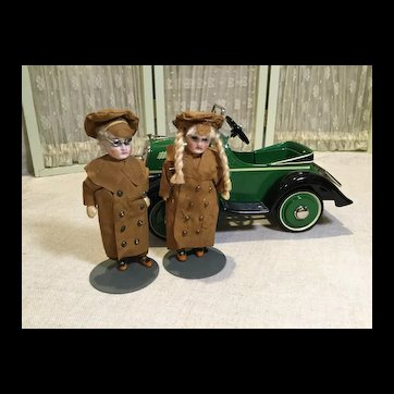 Tiny Pair of German Bisque Head Dolls in Driving Dusters & Caps