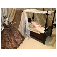 Early 20c. Canopied Doll Bed and Dressings