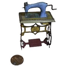 Antique Tin Penny Toy Sewing Machine by Meier