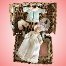 """Miniature 2"""" baby in Basket with Wardrovr"""