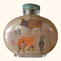 """A Large, 4"""", old, reversed painted snuff bottle, year of the Chou, the Ox."""