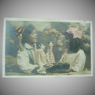 Vintage Postcard of Children and their Puppets