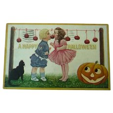 Vintage Halloween Postcard of Children Bobbing for Apples