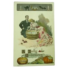 Vintage Halloween Postcard of Couple Bobbing for Apples