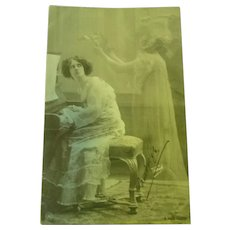 Wonderful Photo Postcard of a lady looking at a ghost.