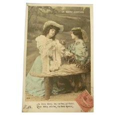 Vintage Postcard of an Edwardian lady getting Her Fortune told