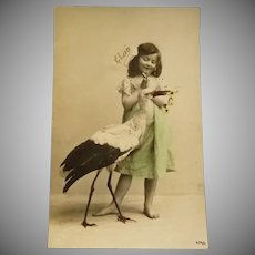 Vintage French Photo Postcard  of an Edwardian Girl and her Pet Stork