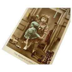Early 1900's French Photo postcard of a Girl and Her Doll at Christmas