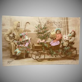 Wonderful Vintage French Real Photo Christmas Postcard of Santa and Children in antique Car