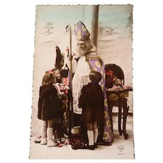 Vintage French Photo Postcard of Santa talking to Several Children