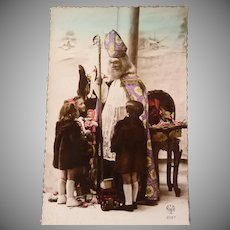 Vintage French Photo Postcard of Santa talking to Several Children